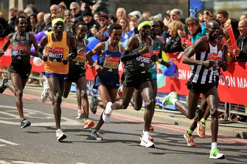 LONDON, ENGLAND - APRIL 24:  Eluid Kipchoge of Kenya (2R) and the elite men make their way under Tower Bridge during the Virgin Money London Marathon on April 24, 2016 in London, England.  (Photo by Ben Hoskins/Getty Images)
